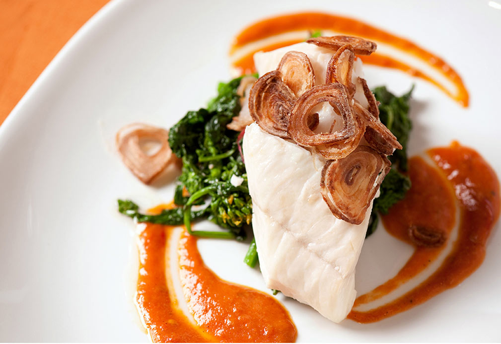 Slow Oil Poached Halibut Over Broccoli Rabe With Almonds And Shallots Confit Roasted Tomato Sauce