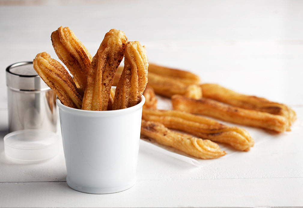Churros with Spiked Chili Cocoa Sugar recipe made with canola oil