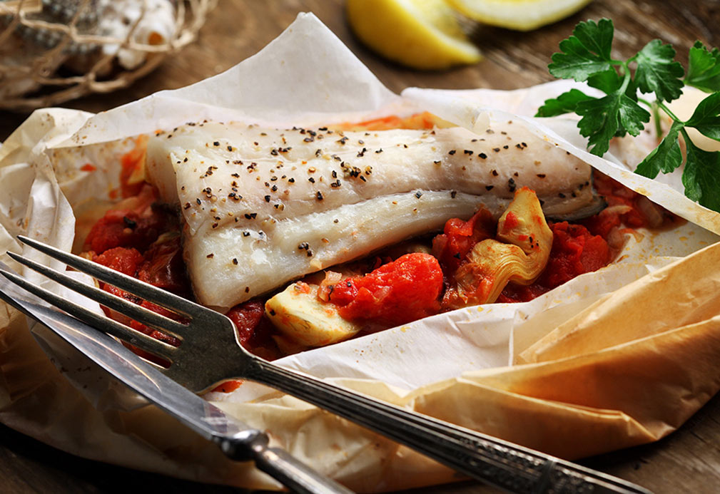 Halibut en Papillote with Roasted Tomato Artichoke Ragout