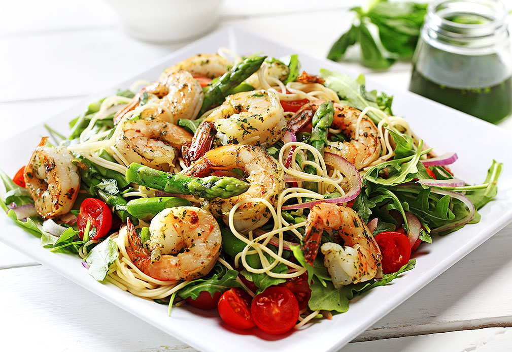 Lemon Basil Canola Oil Over Grilled Prawns And Pasta