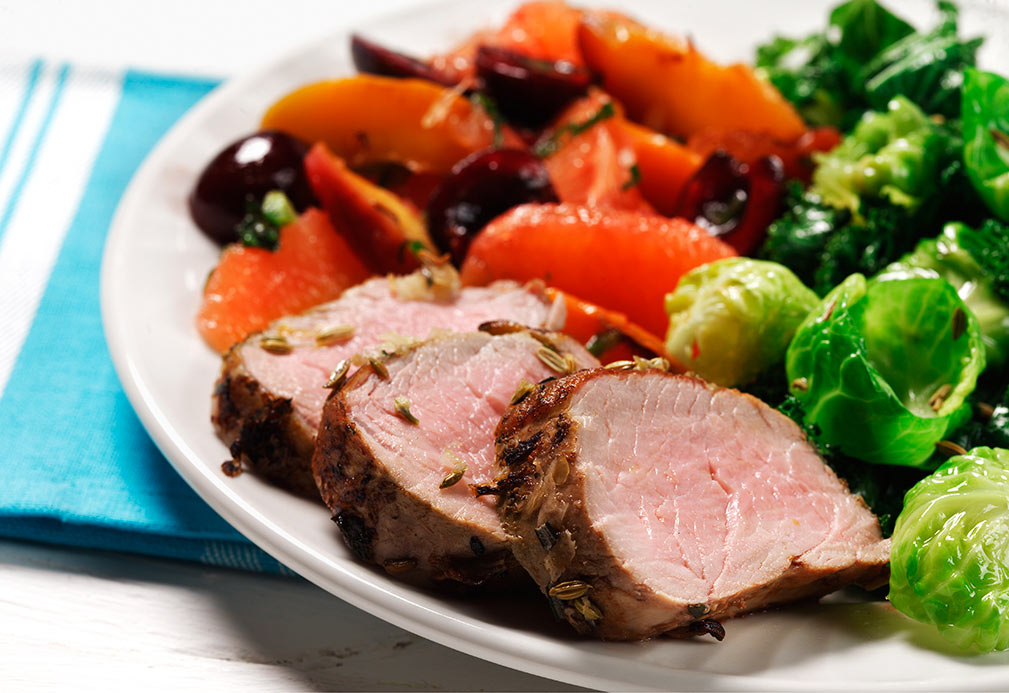 Garlic Rosemary Pork Tenderloin with Fruit Compote Over Greens recipe made with canola oil by Carla Hall
