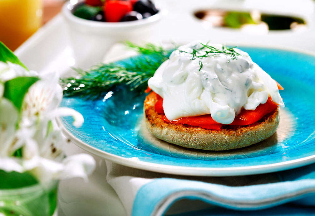 Salmon eggs benedict recipe made with canola oil developed by Ellie Krieger