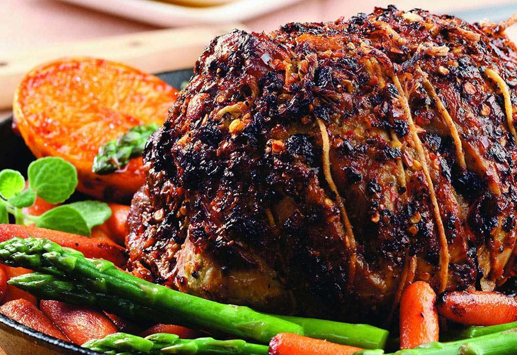 Cerdo asado con chile y naranjas