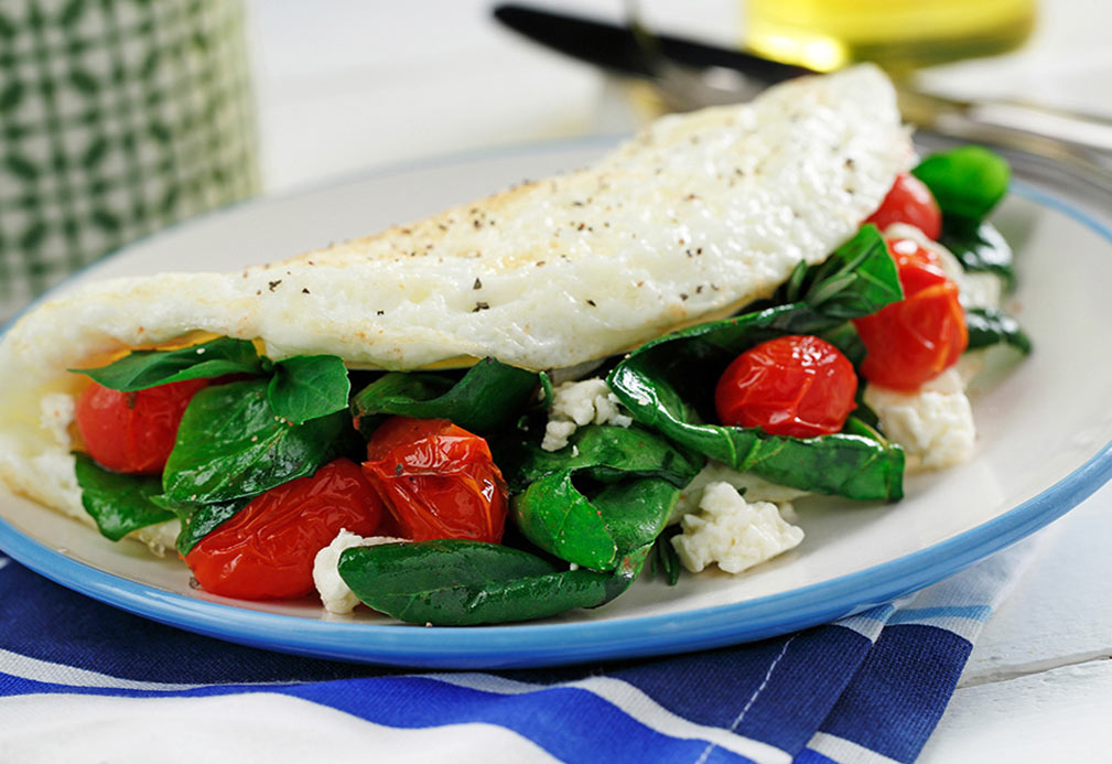 Fresh Spinach and Sweet Tomato Omelette with Feta recipe made with canola oil in partnership with the American Diabetes Association