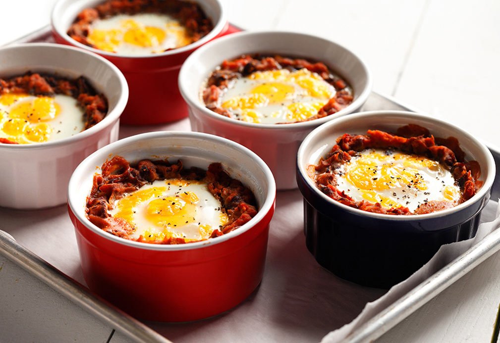 Mexican Baked Eggs on Black Beans recipe made with canola oil by Patricia Chuey