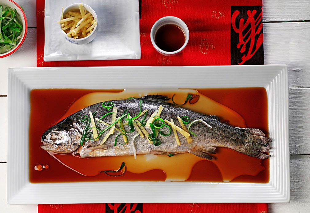Steamed Whole Fish with Ginger and Green Onions recipe made with canola oil by Nathan Fong